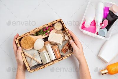 Preparing self care package, seasonal gift box with zero waste cosmetics vs industrial plastic