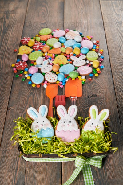 Colorful easter cookies and spatulas on table