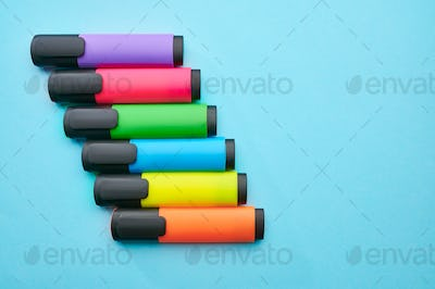 Set of colorful permanent markers, blue background
