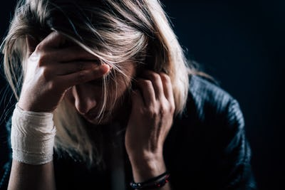 Depression – Depressed woman, covering face with hands