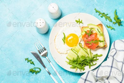 Healthy breakfast with egg, toast and salad.