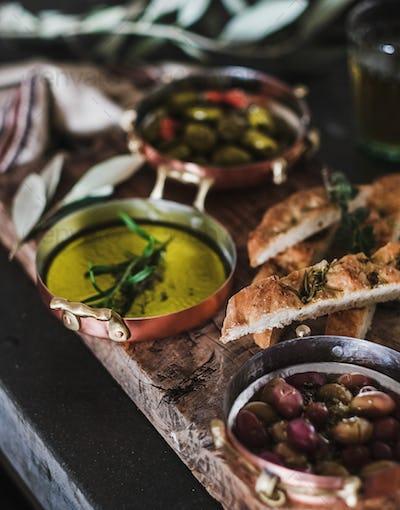 Traditional Mediterranean meze appetizers platter on wooden board