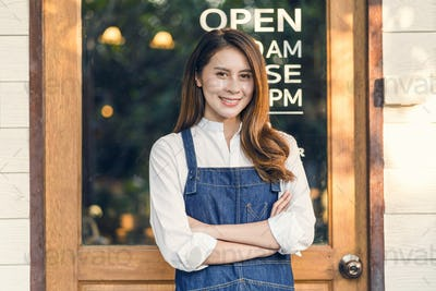 Portrait Asian Small business owner doing Hands crossed for Welcome Open in front of coffee shop
