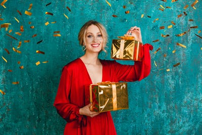 attractive happy smiling woman in stylish red dress celebrating christmas