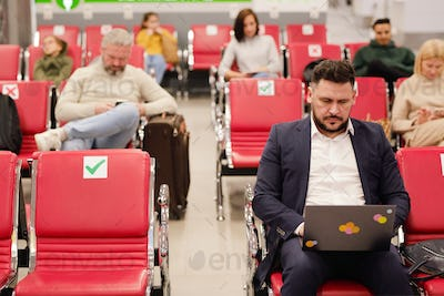 People sitting in terminal airport