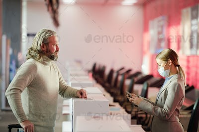 Man stands at the reception desk