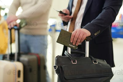 Man with documents at airport