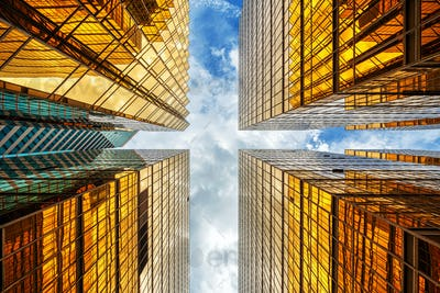 Uprisen angle of Hong Kong skyscraper with reflection of clouds among high building