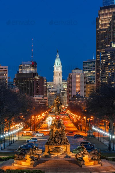 Scene of George Washington statue oand street in Philadelphia over the city hall with cityscape