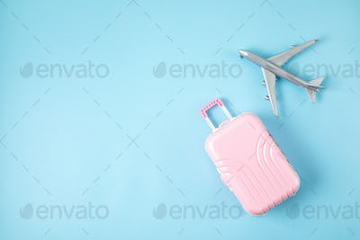 Miniature airplane and suitcase. Travel preparation, tourism, airlines, low cost flights, baggage