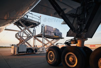 Loading of cargo containers to plane at airport