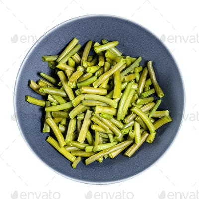 top view of boiled green beans in bowl isolated