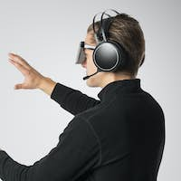 Cool man wearing stereoscopic 3D VR mask with headphones