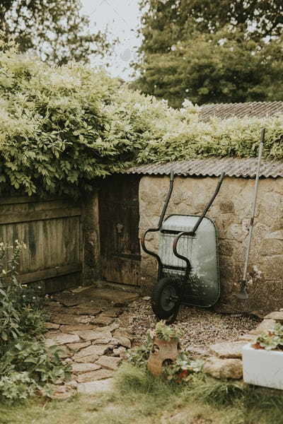 Small backyard home garden with tools