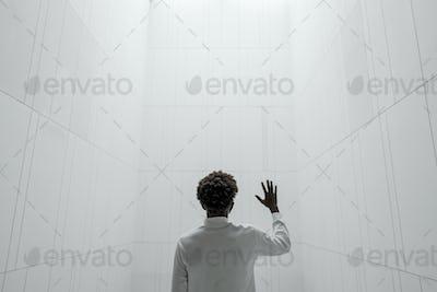 Man in a minimal white interior smart home