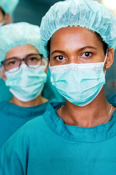 Successful team of surgeon standing in operating room, ready to work on a patient