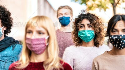 Urban crowd of citizens walking on city street covered by face mask