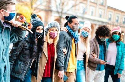 Millennial people group walking and having fun together wearing face mask