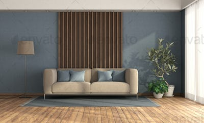 Living room with sofa against wooden panel