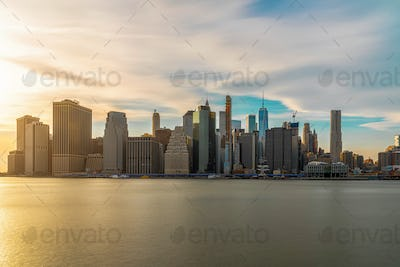 New york Cityscape with Brooklyn Bridge over the east river at the evening time,