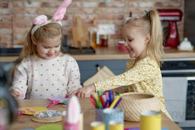 Two girls making decorations for Easter