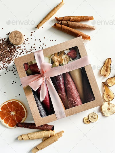 Fruit leather cones in cardboard box close up view. No sugar fruit leather cones. Healthy food.
