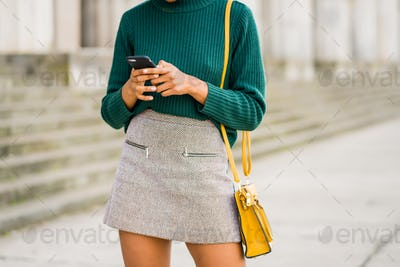 Businesswoman using her mobile phone outdoors.