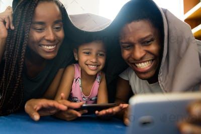 Family taking a selfie with phone.