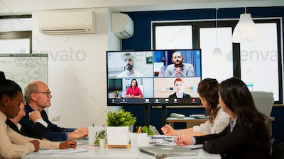 Headshot screen application view of remote multiracial employees talking on video call