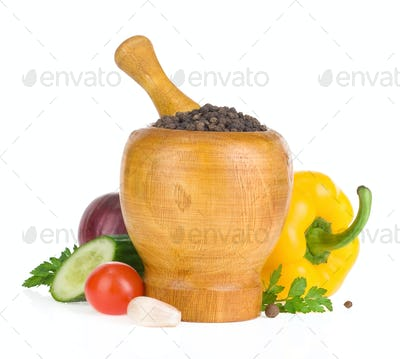 mortar with pestle and spices isolated on white
