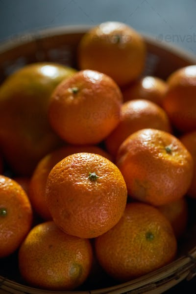 The tangerines in the basket