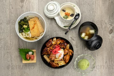 Top view of japanese foods set, chicken fried with rice and egg on top, soup and ice scream