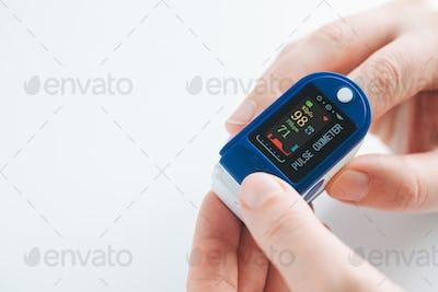 Pulse Oximeter finger digital device to measure oxygen saturation in blood.