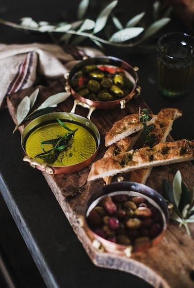Pickled Greek olives, olive oil and herbed focaccia slices