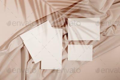 Mockup of blank cards and envelopes over neutral beige background