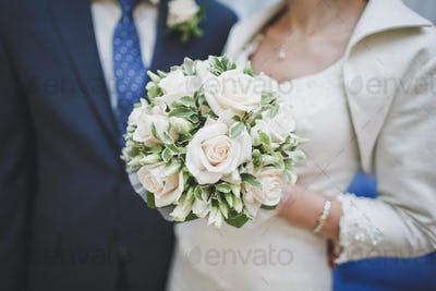 Bridal bouquet of various roses.