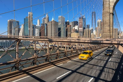 Traffic in morning rush hour before working day on the Brooklyn bridge over New York cityscape
