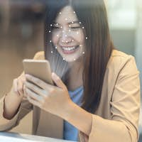 Asian women using the technology tablet for access control by face recognition