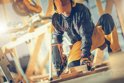 Construction Worker with Nail Gun in His Hand