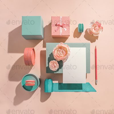 Festive geometric arrangement of gift boxes in muted pastel colors. Congratulations on women's day