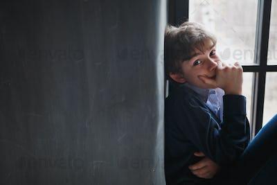 Pensive boy teenager.