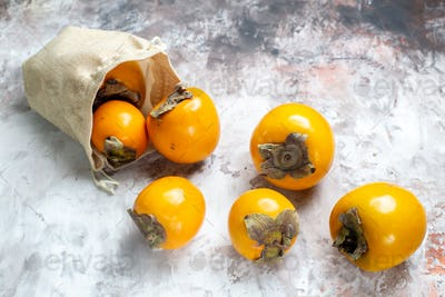 front view fresh persimmons on light background fruit photo ripe tree healthy life color
