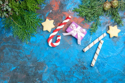 top view little presents with candies on blue background photo color christmas holiday new year