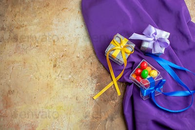 top view little presents on light background color photo gift new year xmas free space