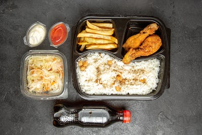 Above view of favourite meal set for dinner or lunch with cola