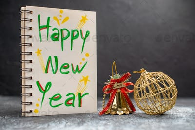 front view happy new year writing on notepad on a grey background photo xmas holiday color new year