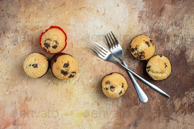 top view yummy choco cakes on brown wooden background sugar dessert color photo sweet pie