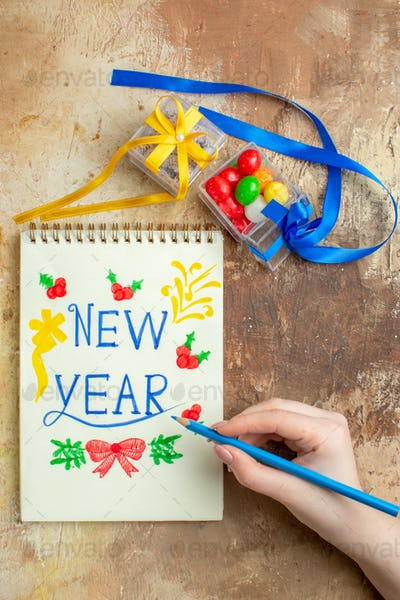 top view new year note with toys on brown background photo xmas holiday color free place