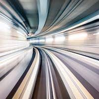 Subway underground tunnel with blurry rail tracks in metro gallery