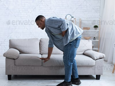 Black Guy Having Stomachache Touching Stomach Suffering From Spasm Indoor